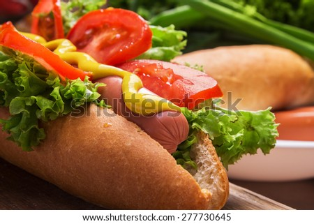 Delicious hot dog for the whole family - stock photo