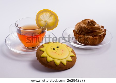 Delicious hot tea with cake and biscuit. - stock photo