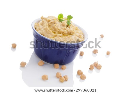 Delicious hummus in ceramic pot and chickpeas isolated on white background. Traditional eastern eating. - stock photo