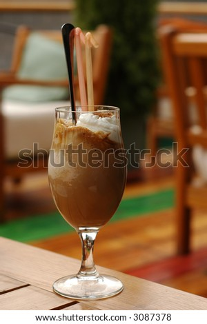 Delicious ice coffee in a long glass - stock photo