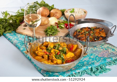 Delicious Indian dishes on a table - stock photo