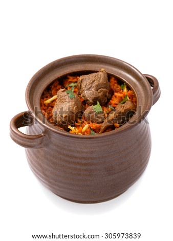 delicious indian dum biryani lamb served in pottery isolated on white background - stock photo