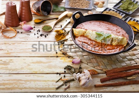 delicious indian murg patiala served with curry sauces with copy space and seasoning around - stock photo