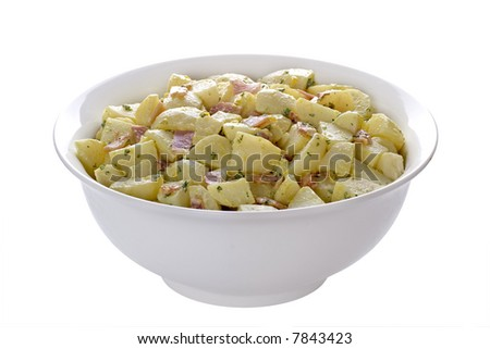 Delicious isolated dish of potato salad, with cooked chopped bacon and parsley