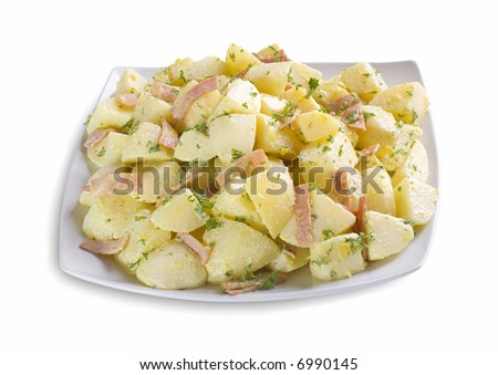 Delicious isolated dish of potato salad, with sliced ham and parsley