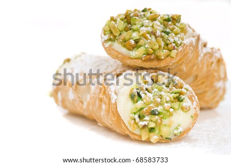 Delicious Italian Cannoli with pistachio nuts and powdered sugar - stock photo