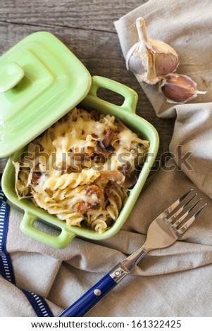 Delicious Italian Fusilli with cheese and champignons - stock photo