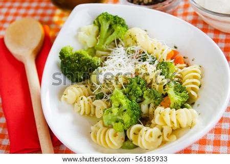 Delicious italian pasta with broccoli in white bowl - stock photo