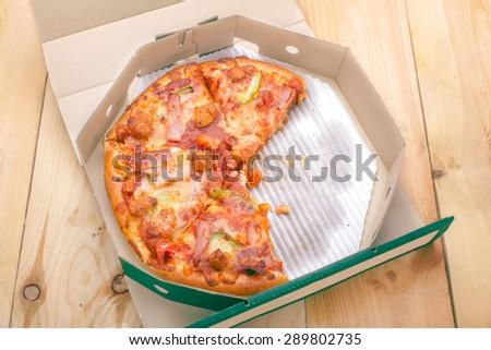 Delicious italian pizza in a box - stock photo