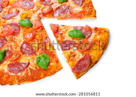 Delicious italian pizza with salami, cherry tomatoes and basil fresh leaves - thin pastry crust isolated at white background - stock photo
