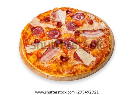 Delicious italian pizza with salami, sausages, bacon, parmesan and cherry tomatoes - thin pastry crust at white background, isolated on wooden desk - stock photo