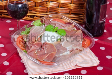 Delicious italian salad with mozzarella bufala and ham