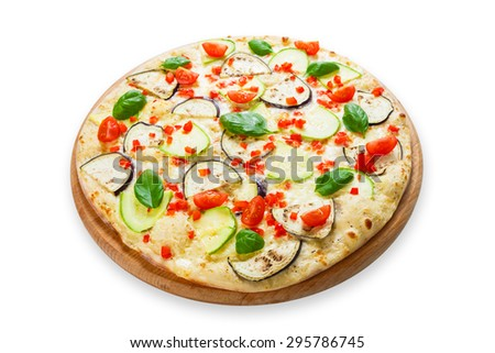 Delicious italian vegetarian pizza with cherry tomatoes, peppers, aubergines and zucchini - thin pastry crust at white table background - stock photo