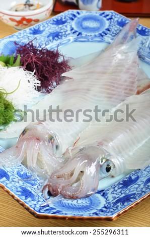 Delicious Japanese fresh raw seafood - calamari sashimi  - stock photo