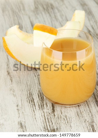 Delicious juice of melon on table close-up