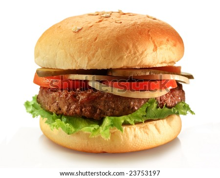 Delicious juicy grilled burger on wheat buns. Studio macro shot - stock photo