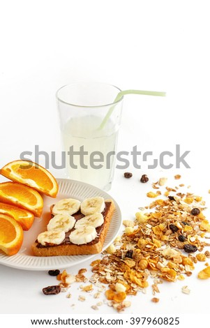 delicious juicy oranges and banana on bread with chocolate and fresh drink and granola  on white background, health eating concept - stock photo