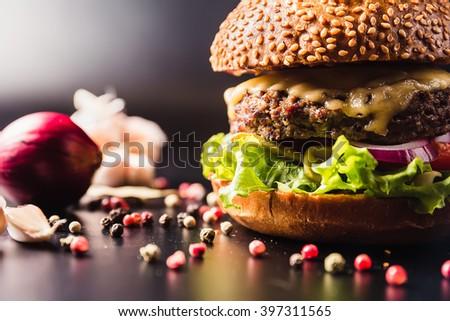 Delicious juicy stuffing big burger - stock photo
