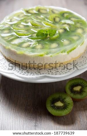 delicious kiwi fruit cake with soy whipped cream - stock photo
