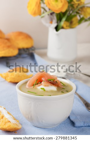 Delicious leek cream soup with smoked salmon and cream cheese, selective focus - stock photo