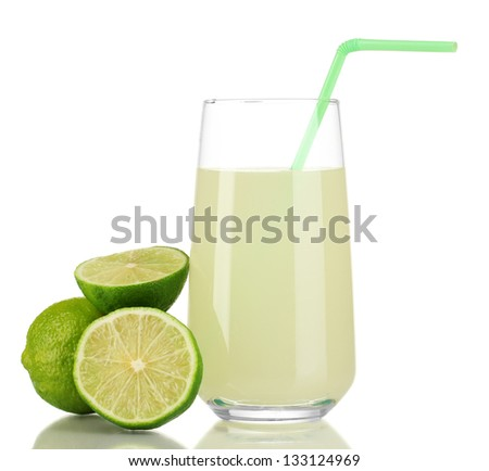 Delicious lemon juice in glass and limes next to it isolated on white - stock photo