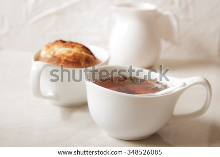 delicious lemon muffins with tea and coffee romantic mood. - stock photo