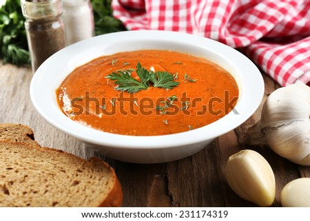 Delicious lentil cream-soup on table close-up - stock photo