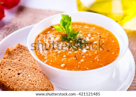 Delicious lentil cream-soup with vegetables and toast - stock photo