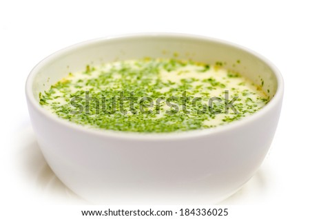 delicious light cream soup with parsley isolated on white background - stock photo
