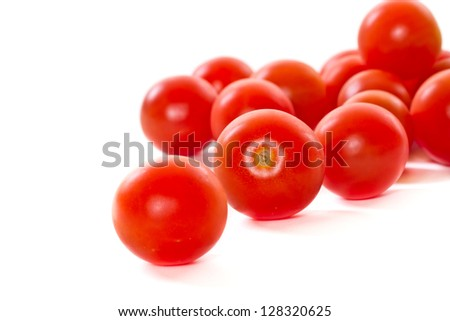 delicious little cherry tomatoes on a white background