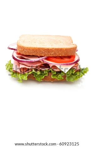 Delicious looking ham sandwich on white background - stock photo