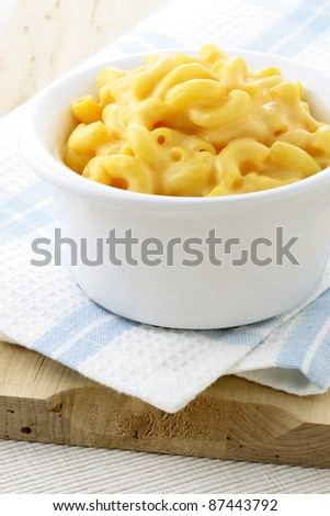 Delicious mac and cheese made with a smooth, creamy sauce. This macaroni and cheese family favorite is always a welcomed addition for lunch or at dinnertime. - stock photo