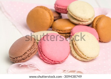 Delicious Macarons, French Pastry Cookies with Cream.