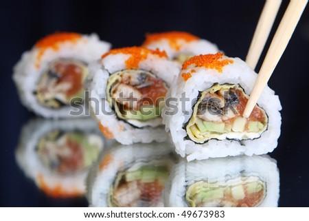 Delicious maki sushi with caviar - stock photo