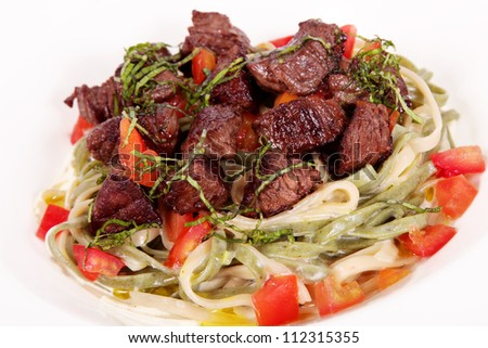 delicious meal of meat and salad over white background - stock photo