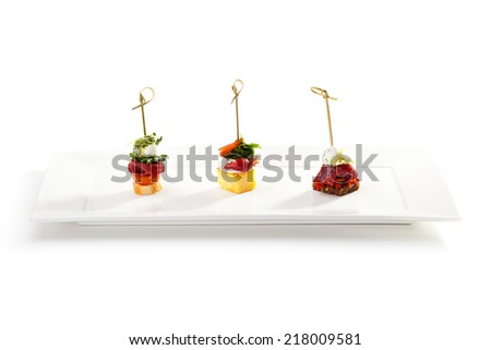 Delicious Meat and Vegetables Canapes - stock photo