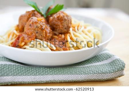 Delicious meatball with spaghetti in tomato sauce - stock photo