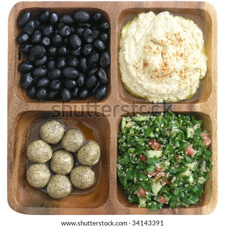 delicious Mediterranean food: kalamata olives, hummus, tabouleh, and pickled shankleesh - stock photo
