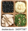 delicious Mediterranean food: kalamata olives, hummus, tabouleh, and pita bread - stock photo