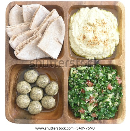 delicious Mediterranean food: pita bread, hummus, tabouleh, and pickled shankleesh - stock photo