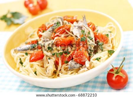 Delicious Mediterranean pasta with sardine, tomato and parsley - stock photo