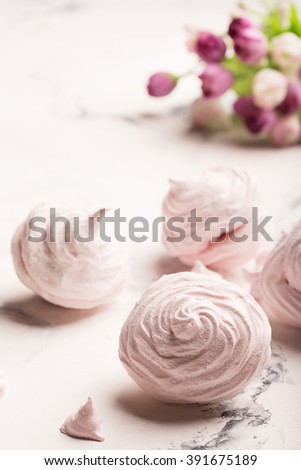 Delicious meringue on the light table. White background