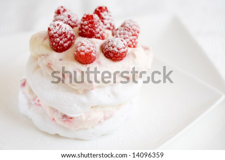 Delicious meringue with raspberry cream and fresh raspberries - stock photo