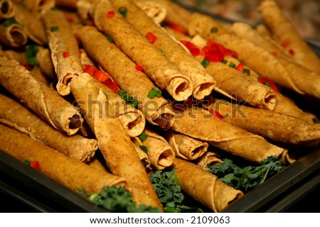 Delicious Mexican food called taquitos - stock photo
