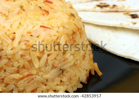 Delicious  mexican rice and tortillas  colorful exquisite gourmet food - stock photo