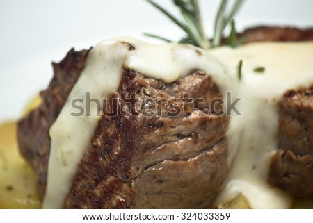 Delicious Mignon Medallion of the Gruyere cheese sauce accompanied by potato. - stock photo