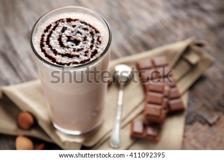 Delicious milk cocktail on rustic background, close up - stock photo