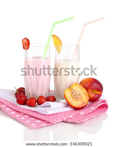 Delicious milk shakes with strawberries and peach isolated on white