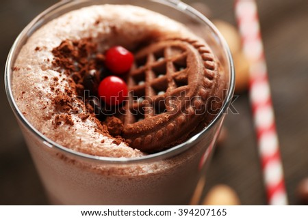 Delicious milkshake cocktail on rustic wooden table, close up - stock photo