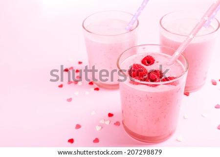 Delicious milkshake on table - stock photo